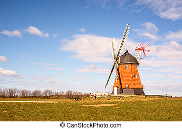 Mill on a green meadow in the spring
