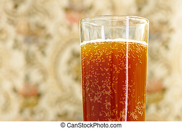 glass with carbonated drink on blurred background