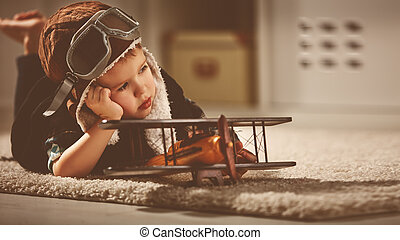 concept of dreams and travels. pilot aviator child with a...