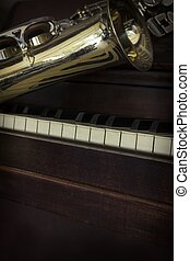 Old Saxophone Piano - Old and worn Jazz saxophone and piano...