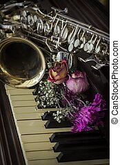 Flowers Saxophone Piano - Old and worn Jazz saxophone and...