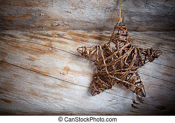 Rustic star - Rustic heart hanging against weathered wood