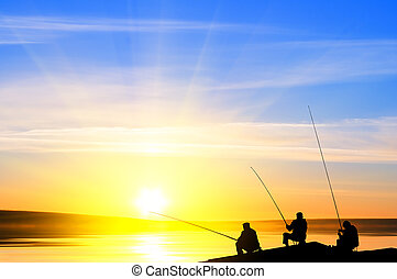 Fishermans fishing before sunset - Fishermans fishing on a...