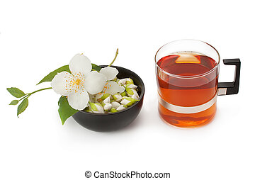 green tea with jasmine flowers isolated on white background