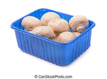 Mushrooms in plastic box