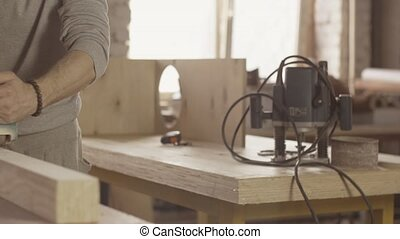 Joiner process long wooden board by belt sander Move forward...