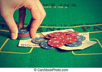 Man betting on poker - Man betting with poker chips...