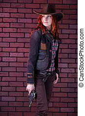Pretty cowgirl - Pretty redhaired cowgirl with the revolver....