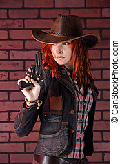 Pretty cowgirl with the revolver Brick background