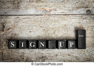 keys on a wooden table with the words sign up ,conceptual