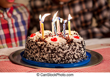 Cake's candles being blown out. Birthday candles in the...