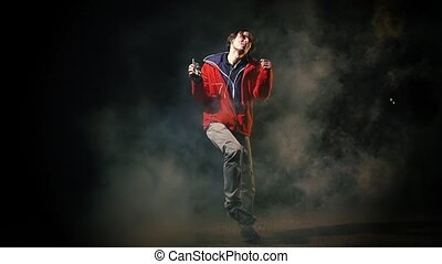 Man dancing Hip-hop in night  smoke urban