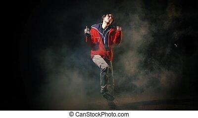 Man dancing Hip-hop in night  smoke urban