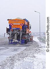 Salt spreader truck - Snowplow truck with salt spreader at...