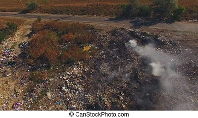 Burning Of Huge Wastes Dump - AERIAL VIEW. This is a flight...