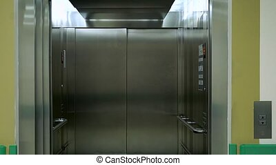 Closing elevator door - An empty modern elevator or lift...