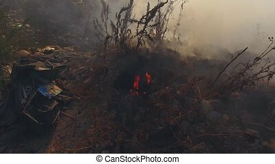 Dump Site With Burning Garbage - Flight over large dump site...