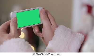 Santa Hold Phone in Hands Green Screen. Phone with Green...