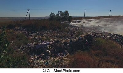 Burning Garbage Dump At Suburbs - AERIAL VIEW Pan shot of a...