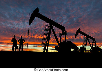 Silhouettes of Pumpjacks and Oil Workers - Silhouette of oil...