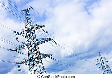 Overhead power lines - high-voltage lines, cloudy sky, the...