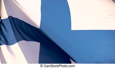 The flag of Finland a blue Nordic cross in Slow Motion - The...