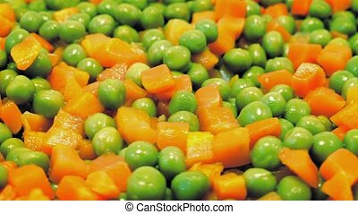 Peas And Carrots Rotating Closeup - Lots of peas and diced...