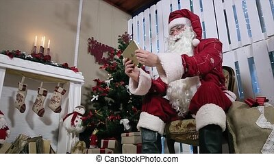 Santa Rotate Digital Tablet on Room with Fireplace and Christmas Tree