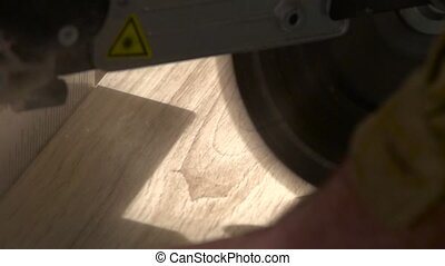 Sawing laminate pieces with electric saw Super Slow Motion -...