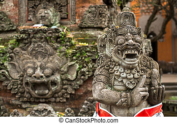 Traditional demon statue carved in stone on Bali, Indonesia