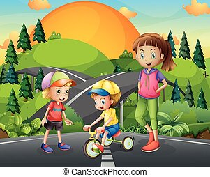 Three kids playing on the road