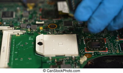 Put computer cpu chip in the socket of motherboard