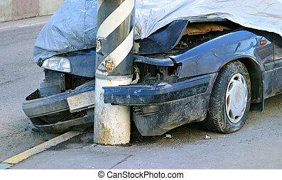 Broken crashed car on the street