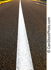 line road markings - photographed close up of white line...