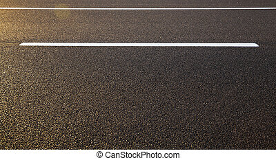 road markings , asphalt - photographed close-up of road...