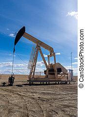 Pumpjack in Rural Alberta, Canada - A pumpjack extracting...