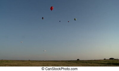 Hot air balloons festival in field on sunny day - View of...