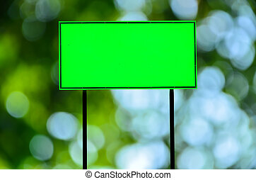 traffic road sign - Green traffic road sign on green nature...