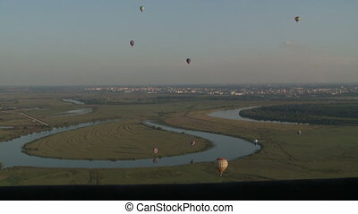 Air balloons festival takes place in countryside - View of...