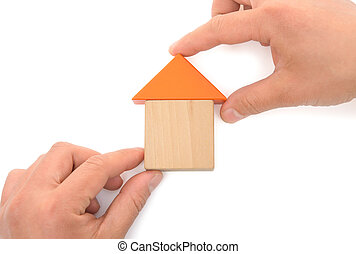 hands making up a house on white with clipping path