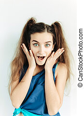 Surprised young girl with pigtails - young beautiful girl...