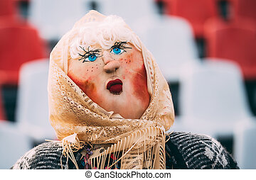 Maslenitsa effigy out of straw,decorated with pieces of rags...