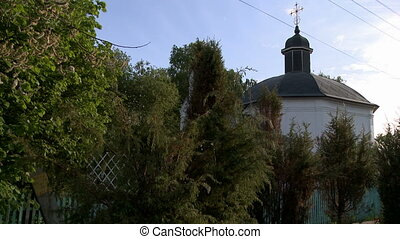 View of beautiful orthodox church at graveyard in summertime