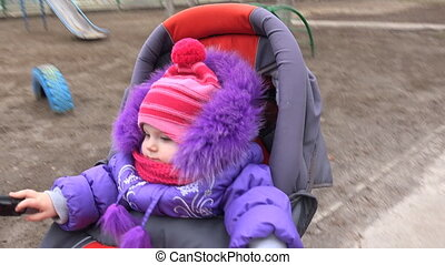 Adorable, Attractive Little Baby Girl in Baby Carriage -...