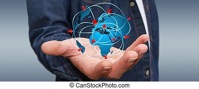 Businessman holding digital world map in his hands -...