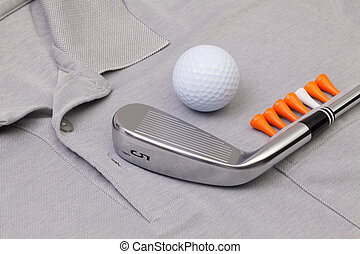 Grey polo shirt and golf equipments - Detail of grey polo...
