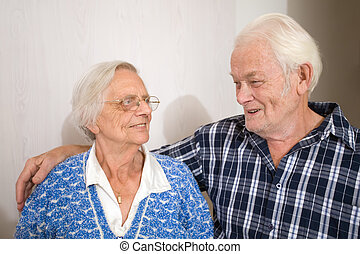 Happy old people - Elderly couple looking at each other...