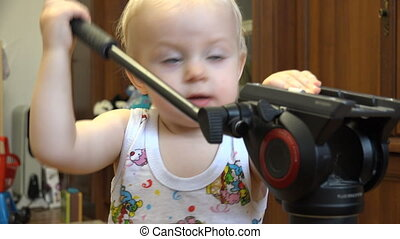 Little Child Discovering Tripod - Little Child Discovering...