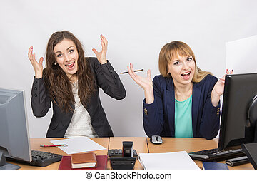 Two employee in the office expressed elation - Two young...