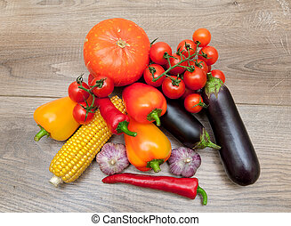 ripe vegetables close-up on wooden background